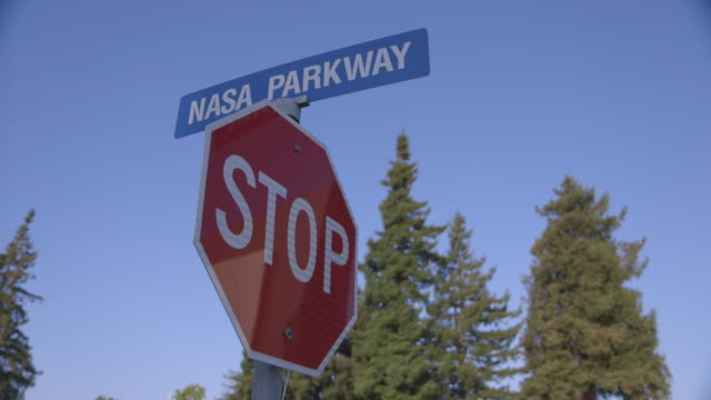 signs reading 'nasa parkway' and 'stop' - octagon stock videos & royalty-free footage