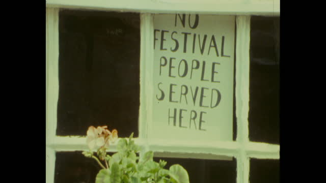 signs saying no festival people served here in shop windows in pilton village due to the 1983 glastonbury festival being on - 1983 stock videos & royalty-free footage