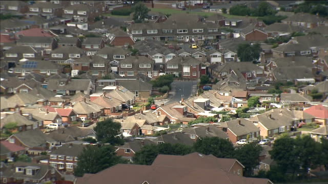signs that the housing market may be cooling t13081314 / tx cleveland redcar residential housing estate housing seen beyond rock outcrop end lib - outcrop stock videos & royalty-free footage