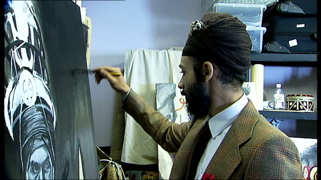 artist jatinder singh durhailay wins people's choice award; england: london: int jatinder singh durhailay painting in studio close shot painting by... - people's choice awards stock videos & royalty-free footage