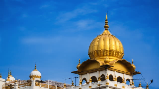 sikh golden temple dome, blue sky thailand. - guru stock videos & royalty-free footage