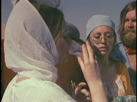 sikh holy man holds a sword and sprinkles water on a woman facing him; she takes his cup and drinks. - healthcare and medicine or illness or food and drink or fitness or exercise or wellbeing stock videos & royalty-free footage