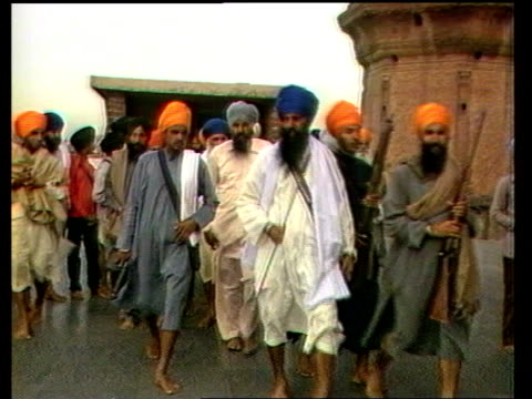 sikh leader sant harchand singh longowal killed; lib / 20.3.85 / upitn india: delhi: int cms sant harchand singh longowal seated and talking to other... - rifle stock videos & royalty-free footage
