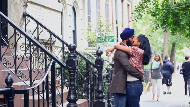 sikh man greeting wife on urban staircase and kissing her - front stoop stock videos and b-roll footage
