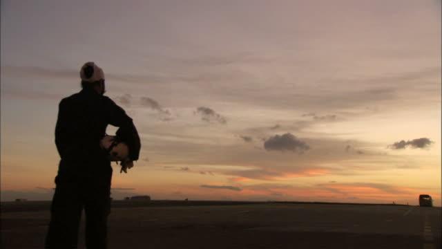WS  Sikh pilot walking with flight helmet on airport /  Bangalore, Karnataka, India