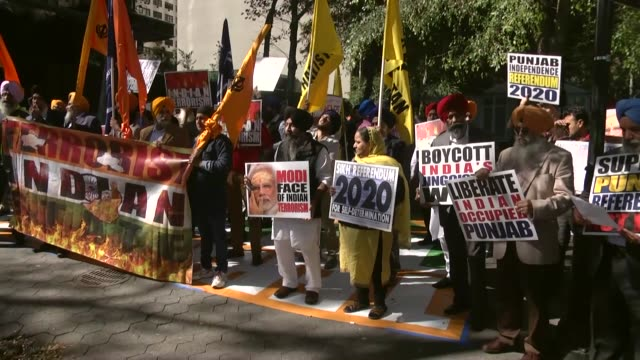 "sikh protesters chants slogans and hold placards in front of the united nations headquarters during the ""save punjab rally"" to demand un intervention... - punjab india stock videos and b-roll footage"