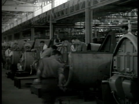 sikorski aircraft factory workers working on airplane part ms workers carrying wing part la ws engineers working on engine motor wwii war production - 1941 stock videos & royalty-free footage