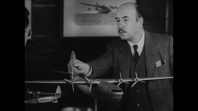 sikorsky aircraft building. russian born igor ivanovich sikorsky in office looking at model airplane, four engine fixed wing. - russian ethnicity stock videos & royalty-free footage
