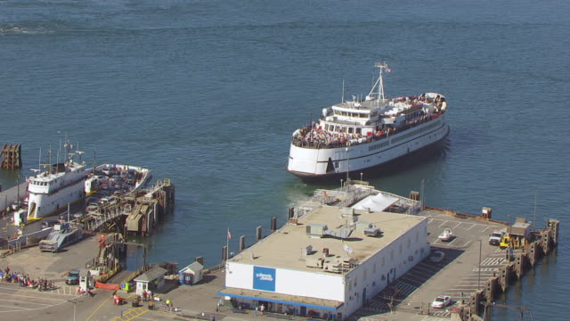 WS AERIAL POV RV Sikuliaq leaving from harbour / Falmouth, Massachusetts, United States