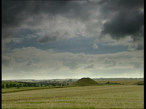 silbury hill prehistoric monument new research itn england wiltshire nr avebury int car following seq has synthesizer music overlaid slow motion... - prehistoric art stock videos & royalty-free footage