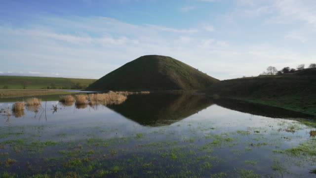 silbury hill (the white pyramid) the day after winter solstice, wiltshire, uk - aquifer stock videos & royalty-free footage