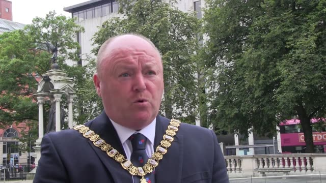 silence was held at belfast city hall during a socially distanced memorial event at the cenotaph. lord mayor frank mccoubrey laid a wreath after the... - vj演出点の映像素材/bロール