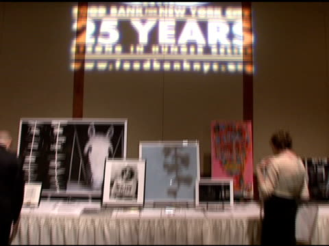 silent auction artwork at the food bank for new york city's 25th anniversary and 5th annual cando awards dinner at abigail kirsch's pier sixty at... - chelsea piers stock videos & royalty-free footage