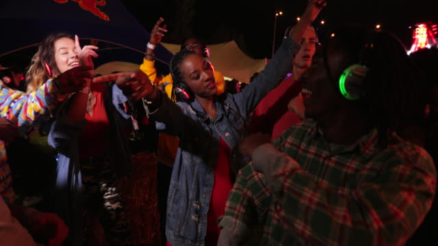 silent disco at a festival - disco dancing stock videos & royalty-free footage