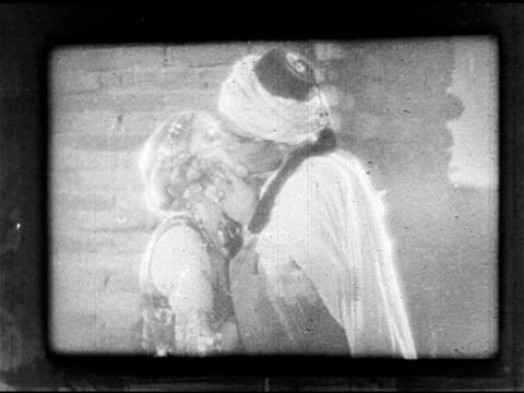 silent film clip w/ rudolph valentino as ahmed kissing vilma blanky as yasmin - 1926 stock videos & royalty-free footage