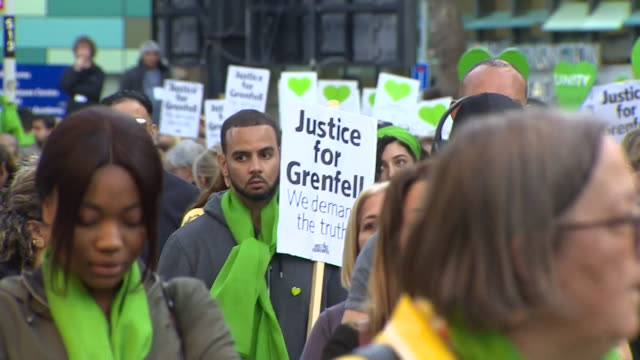 silent march to mark the two year anniversary of the grenfell tower fire - marching stock videos & royalty-free footage