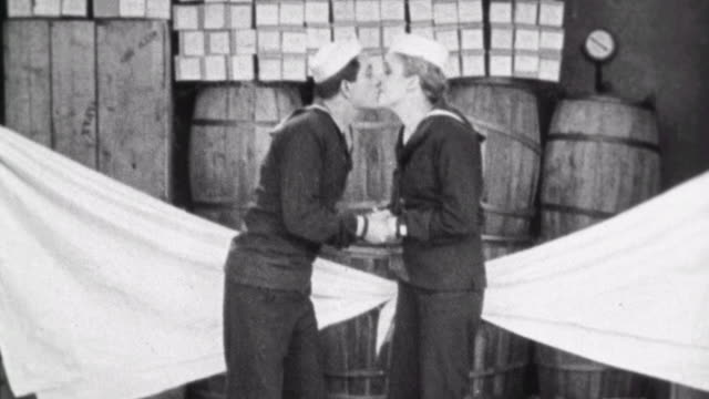 silent short film navy blues / naval recruit must sleep in storage room / girlfriend opens port hole and water rushes in / she is sent to sleep in... - 1923年点の映像素材/bロール