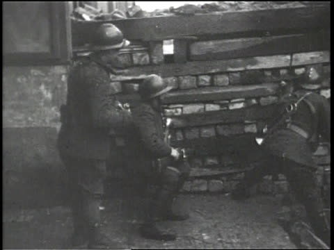 silent stock footage of allied soldiers unpacking hand grenades and aiming rifles through a barricade / cut to a view of a town / a camera placed on... - barricade stock videos & royalty-free footage