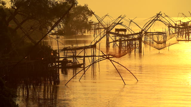 Silhoette scene of fishing trap in southeast asia country.