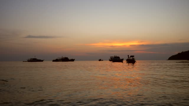 silhouette boats with golden sunset in a sea - crustacean stock videos & royalty-free footage