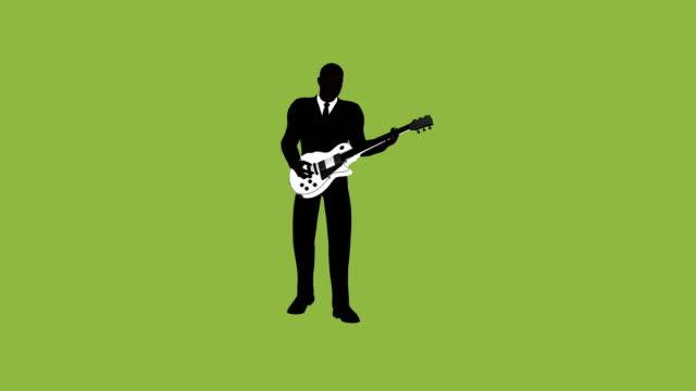 silhouette businessman rockstar guitar animation - rock music stock videos & royalty-free footage