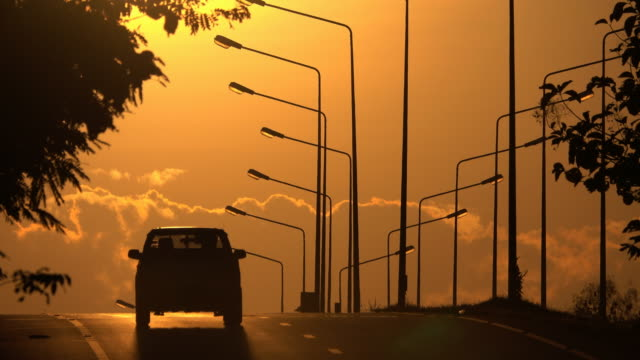 4k silhouette cars on highway road when sunset - southeast asia stock videos & royalty-free footage