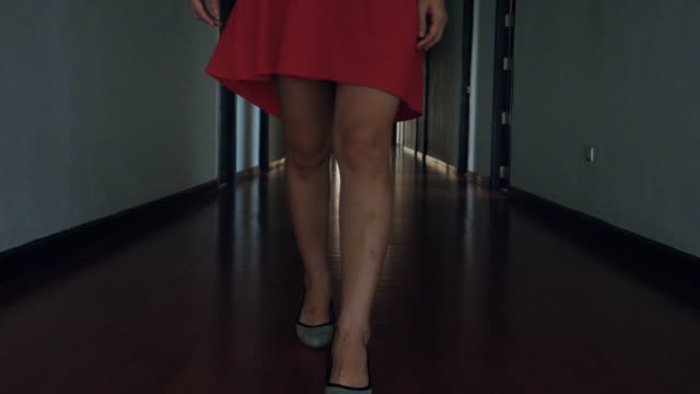 silhouette close-up view businesswoman in red dress walking to work - dress stock videos & royalty-free footage