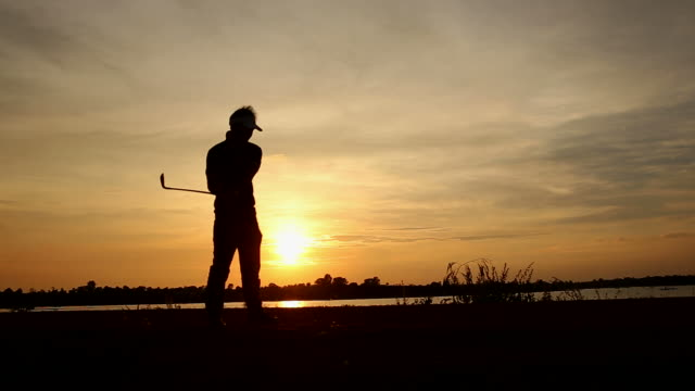 silhouette golfer at sunset - teeing off stock videos & royalty-free footage