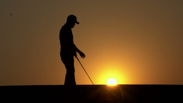 silhouette golfer at sunset - driving range stock videos & royalty-free footage