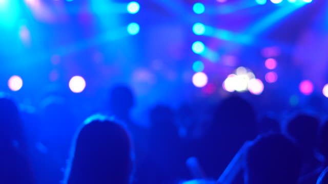 silhouette hands of audience crowd people enjoying the club party concert ,celebrate new year party , blurry night club party music dancing sound , party people blurred background - auditorium stock videos & royalty-free footage