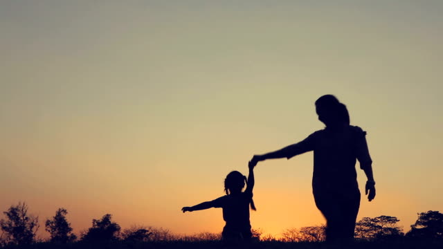silhouette happy family, - daughter stock videos and b-roll footage