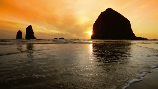 ls, silhouette haystack rock, sunset, cannon beach, oregon - cannon beach stock videos & royalty-free footage
