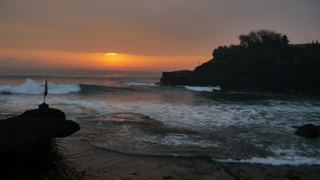 Silhouette hindu temple Pura Tanah Lot and sunset Bali, Indonesia