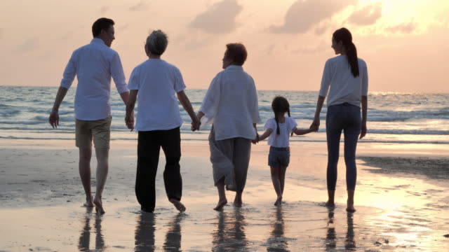 silhouette joyful asian large family walking to sunset sea surf on sand beach.family,lifestyle,people,life insurance,multi-generation, elderly,vacations,relationship,children,holiday,retirement,healthy care concept. - large family stock videos & royalty-free footage