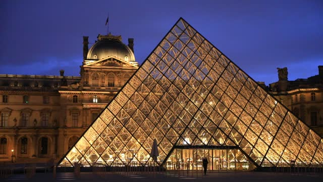 silhouette leaves the louvre pyramid at dusk, the louvre museum which remains closed because of covid19 on january 7, 2021 in paris, france. unlike... - atmospheric mood stock videos & royalty-free footage
