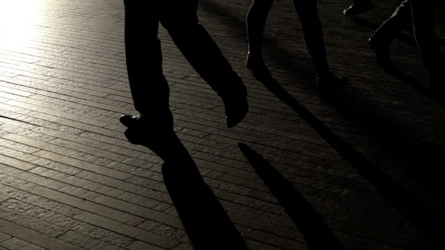 silhouette legs of london commuters walking in slow motion - back lit stock videos & royalty-free footage