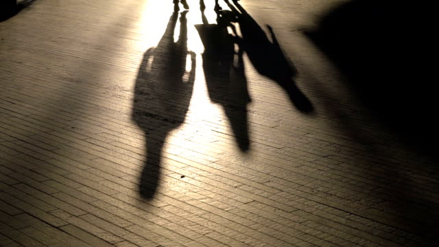 slo mo silhouette legs of london people walking in the morning - controluce video stock e b–roll