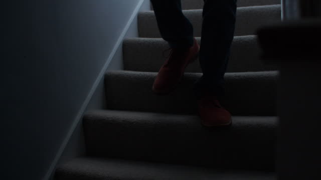 silhouette man walking downstairs at night. 1. - steps and staircases stock videos & royalty-free footage