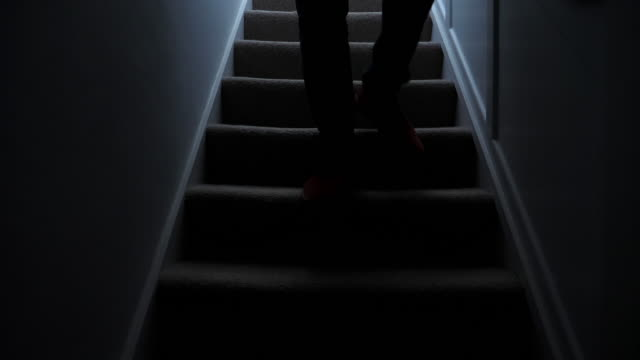 silhouette man walking downstairs at night. 2. - moving down video stock e b–roll