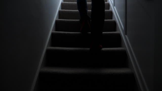 silhouette man walking upstairs at night. 1. - spooky stock videos & royalty-free footage