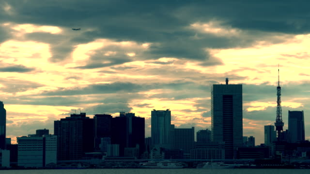 silhouette of a city skyline at dusk - shade stock videos & royalty-free footage