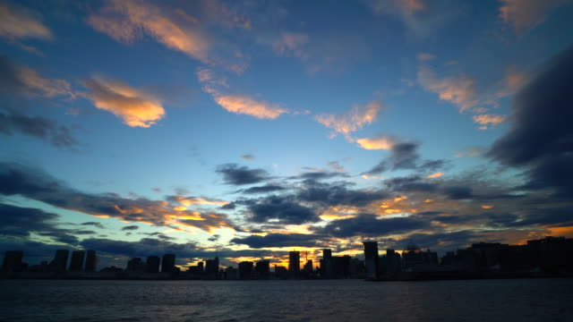 silhouette of a city skyline at dusk - plusphoto stock videos & royalty-free footage