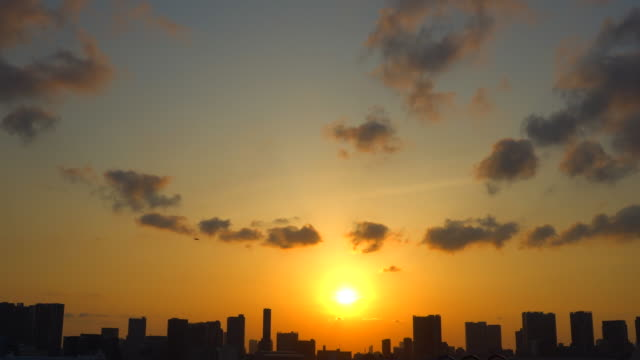 silhouette of a city skyline at sunset - plusphoto stock videos & royalty-free footage