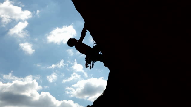 silhouette of a climber - rock climbing stock videos & royalty-free footage