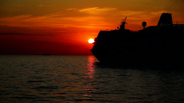 silhouette of a cruise liner at sunset - cruising stock videos & royalty-free footage