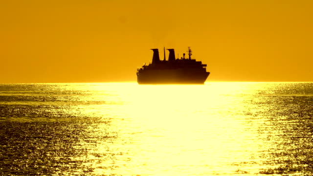 silhouette of a cruise ship at sunset - cruise ship stock videos & royalty-free footage