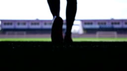 Silhouette of a football player going out to the stadium, slow motion
