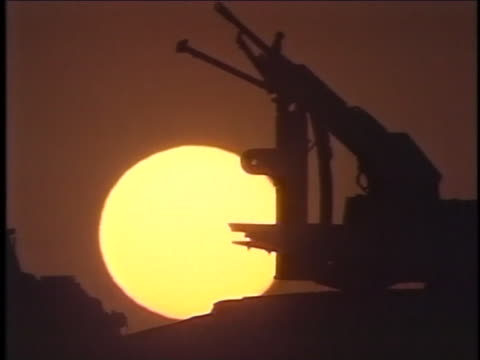 silhouette of a gun atop a military vehicle. - al fallujah stock videos & royalty-free footage