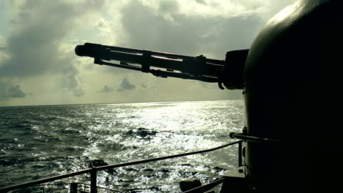 silhouette of a gun of a warship at sunset - warship stock videos & royalty-free footage