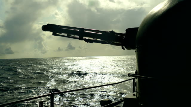 silhouette of a gun of a warship at sunset - battleship stock videos & royalty-free footage
